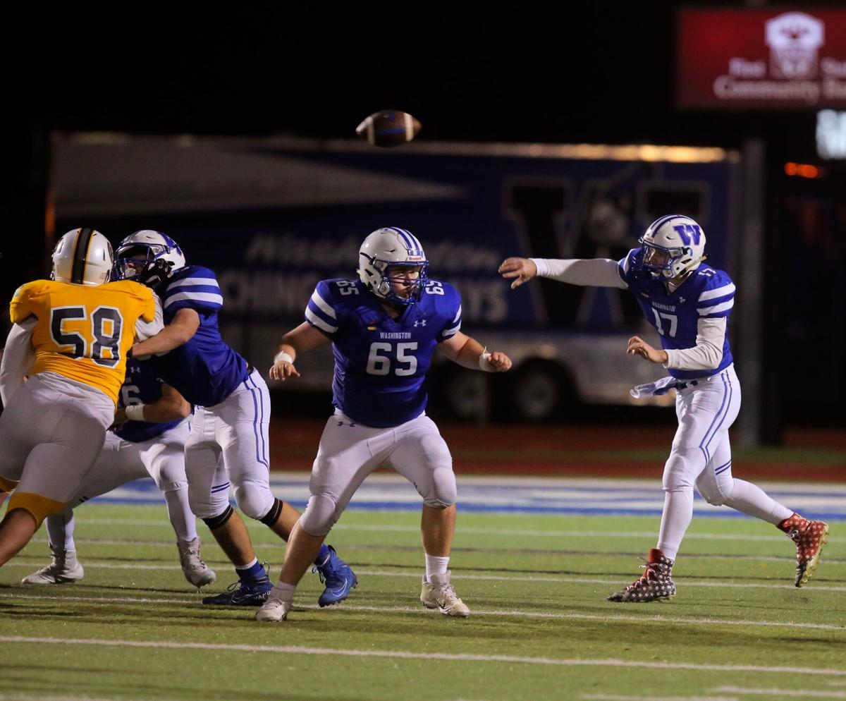 Washington junior Cam Millheiser throws a pass