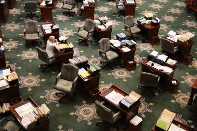 Sen. Lauren Arthur, D-Kansas City, sits in a nearly empty Senate chamber