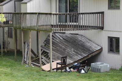 A deck sits collapsed on the ground at Foxfire