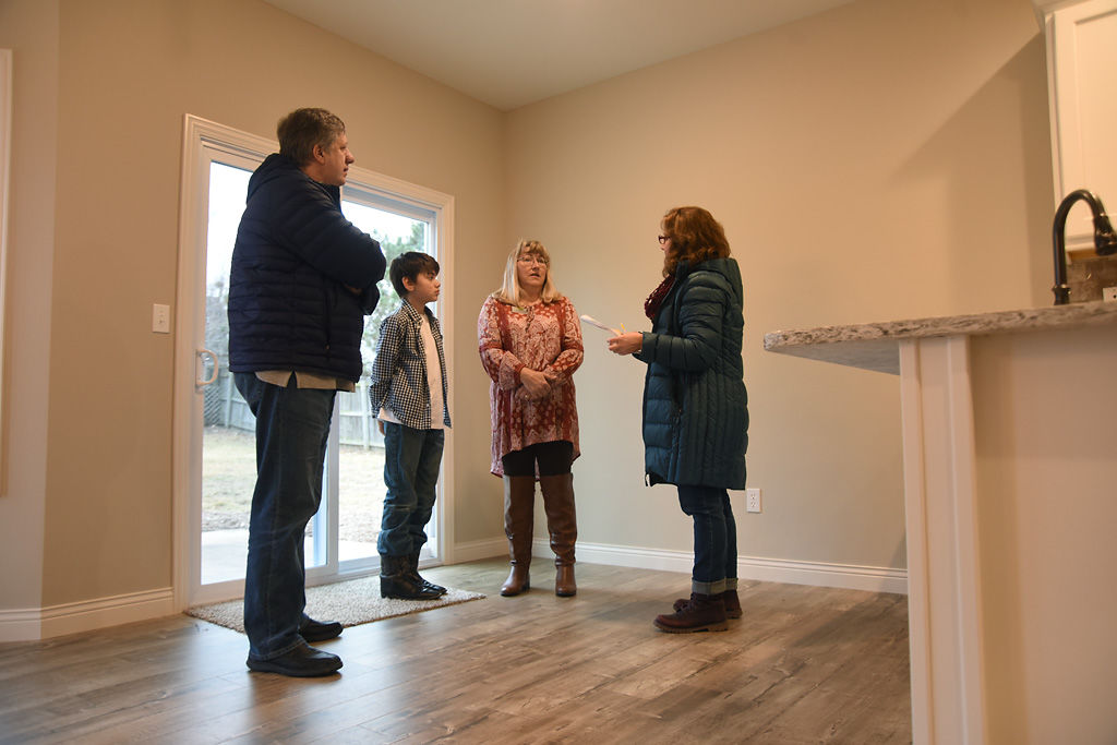 Real estate agent Denise Banks-Thomas shows a house