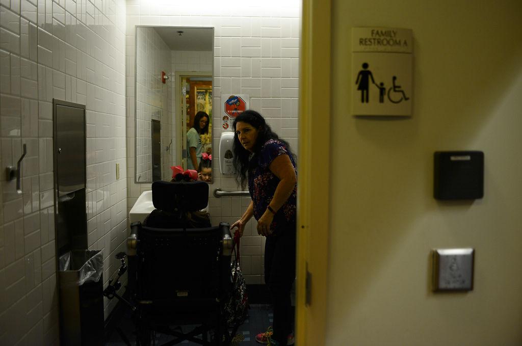 Robyn Schelp holds the door open