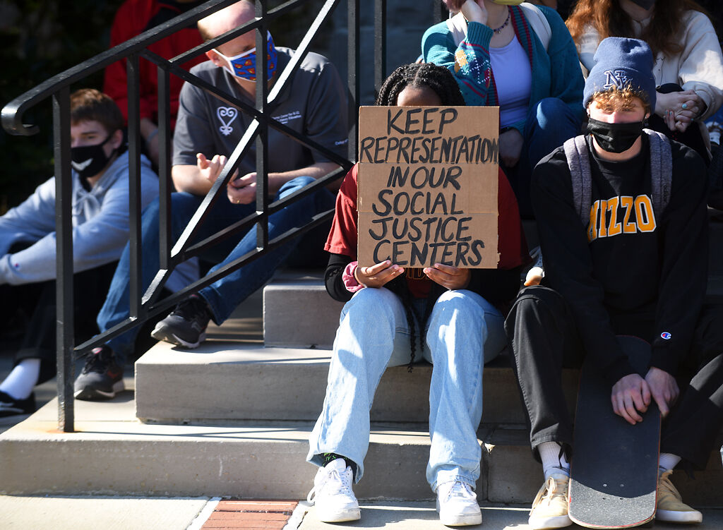 A student holds a sign