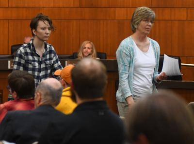 From left, Kai Freter and their mother Carol Sattler testify at the City Council meeting