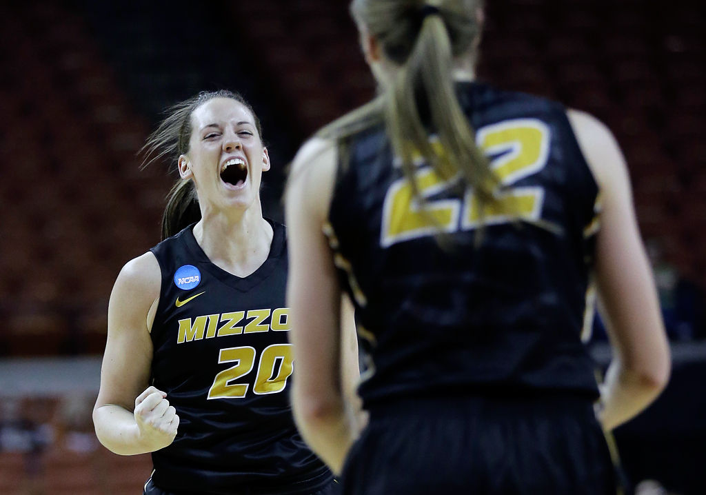 Kayla McDowell celebrates with teammates