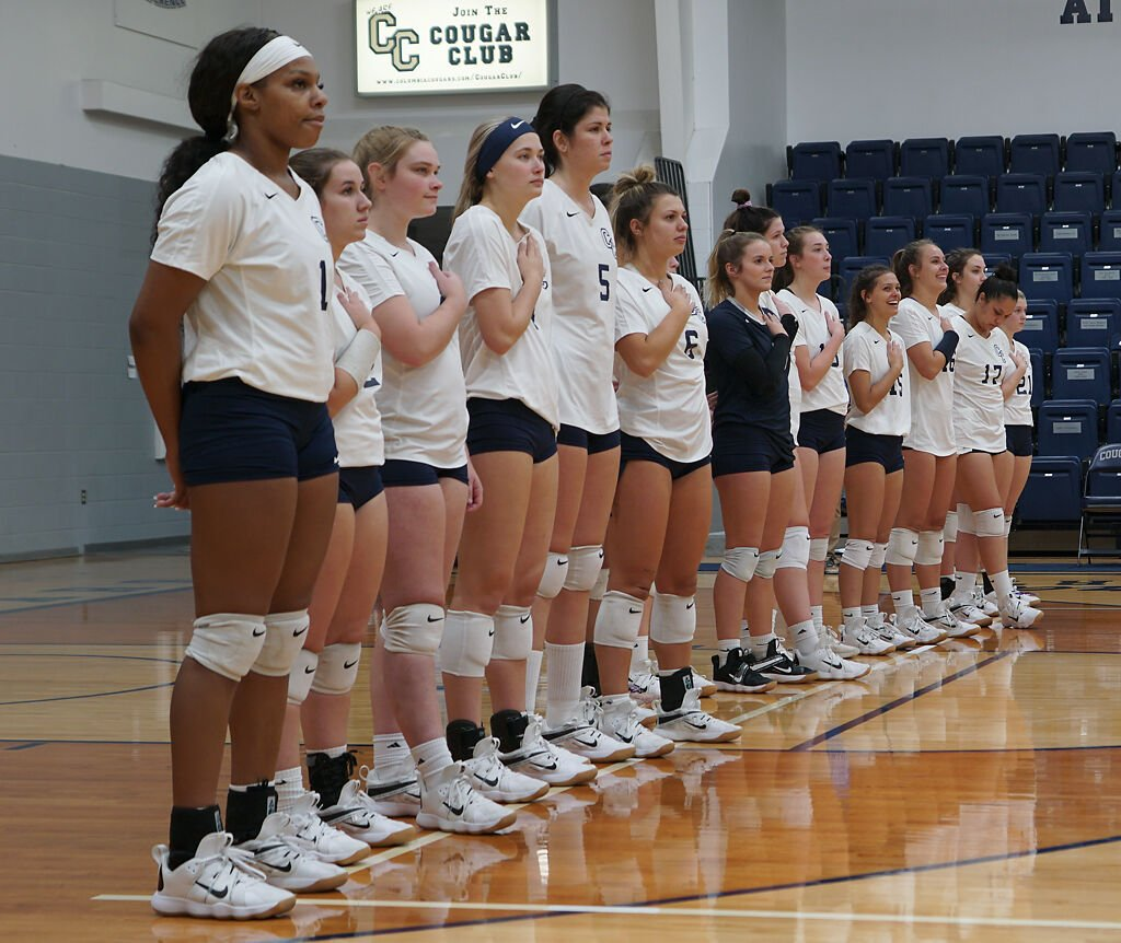 The Columbia College volleyball team stands for the national anthem on Monday at Southwell Complex.