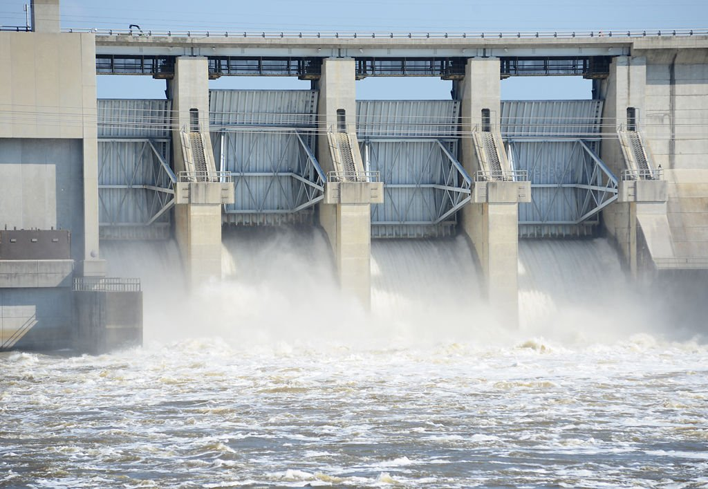 Water rushes through Truman Dam's four floodgates and into the Osage River