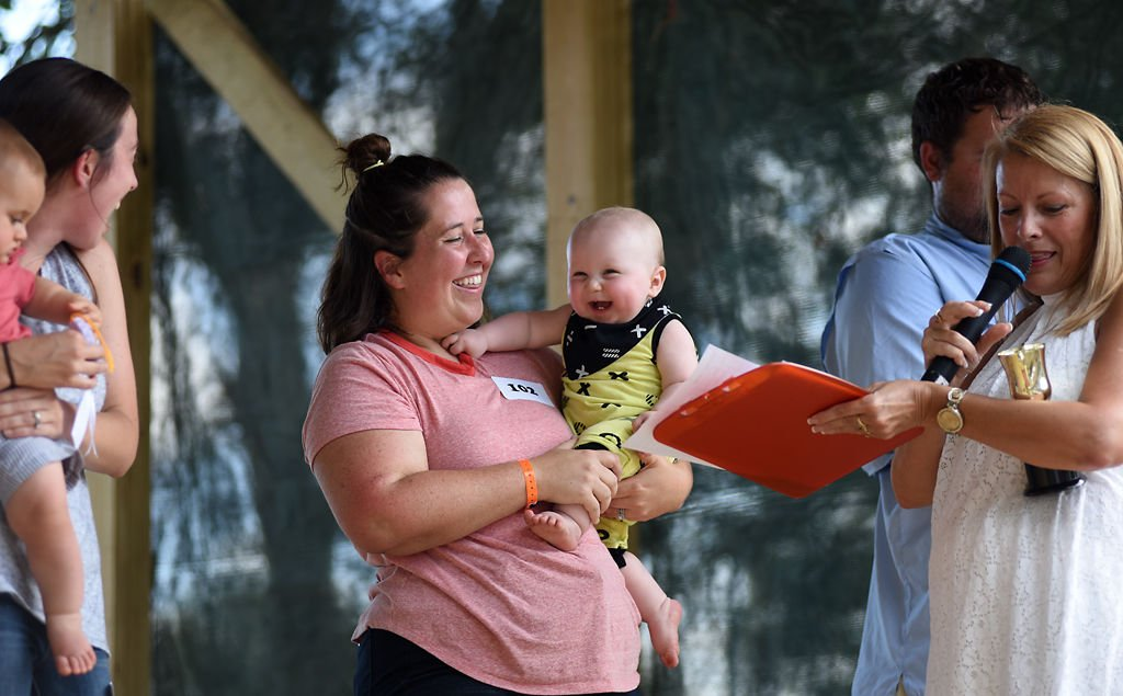 Victoria Smoky and her son Sawyer, 10 months, laugh during the Boone County Fair Baby Contest