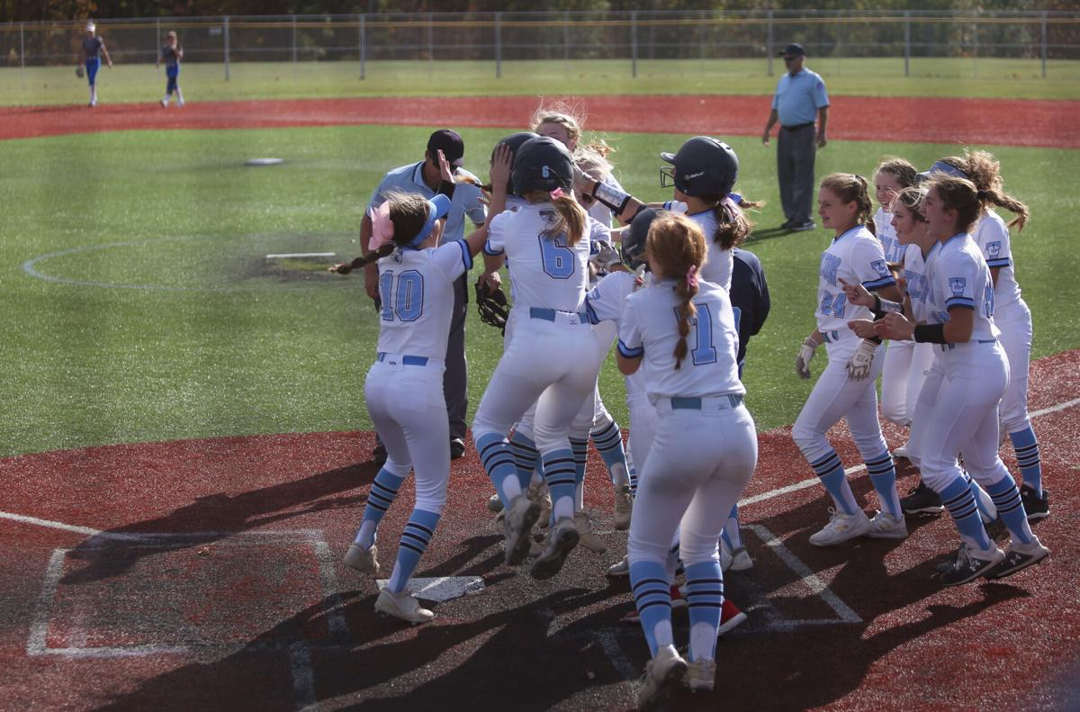 The Tolton Trailblazers softball team celebrates winning the district championship game