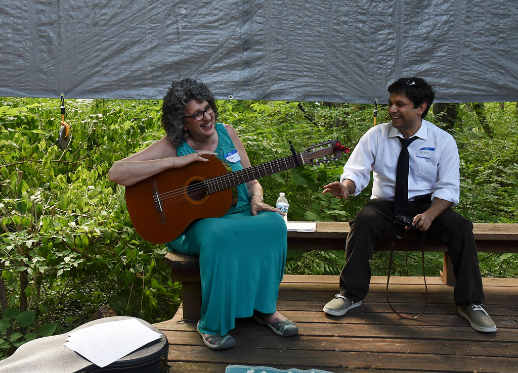 Singer Jamie Meadows, left, laughs with Rishi Sharma