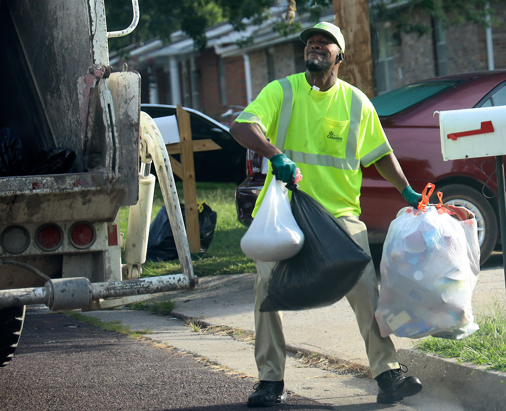 Johnny Clippard collects piles of trash along his route that starts near Cosmo Park