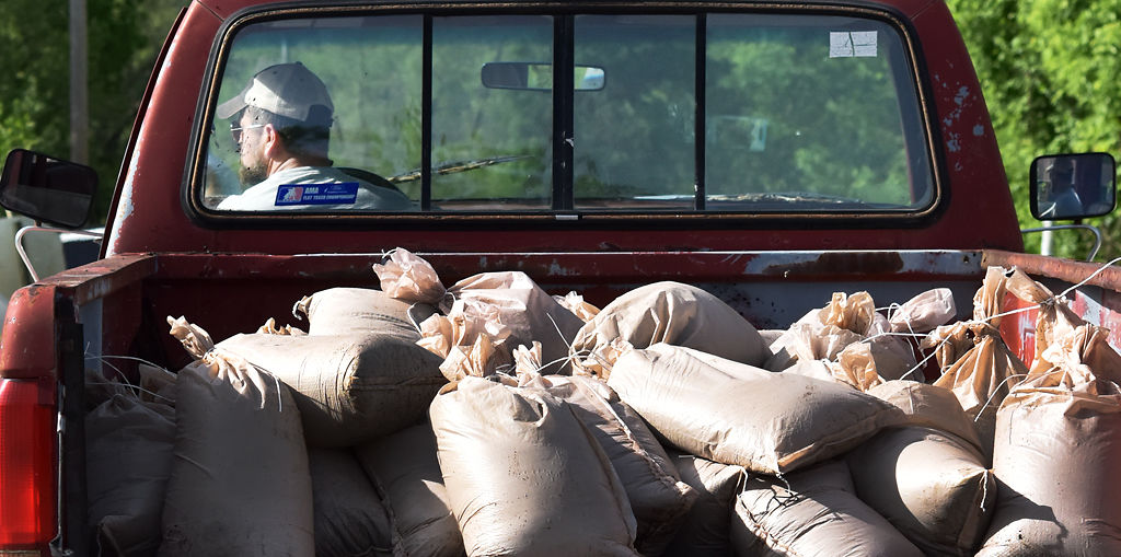 Dawson Claridge drives his truckfull of sandbags