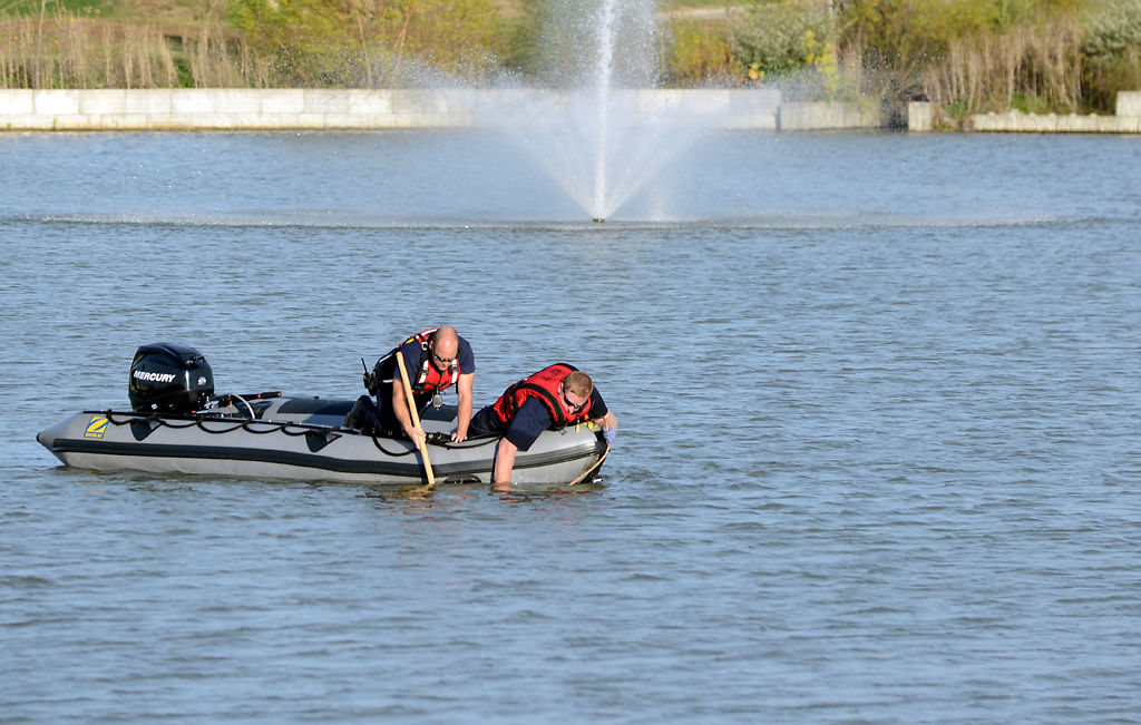 Two rescue workers comb Swan Lake
