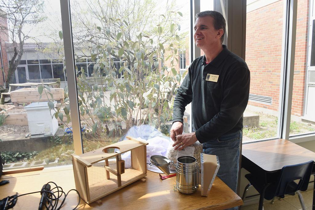 Mike Szydlowski prepares a smoker to calm the bees