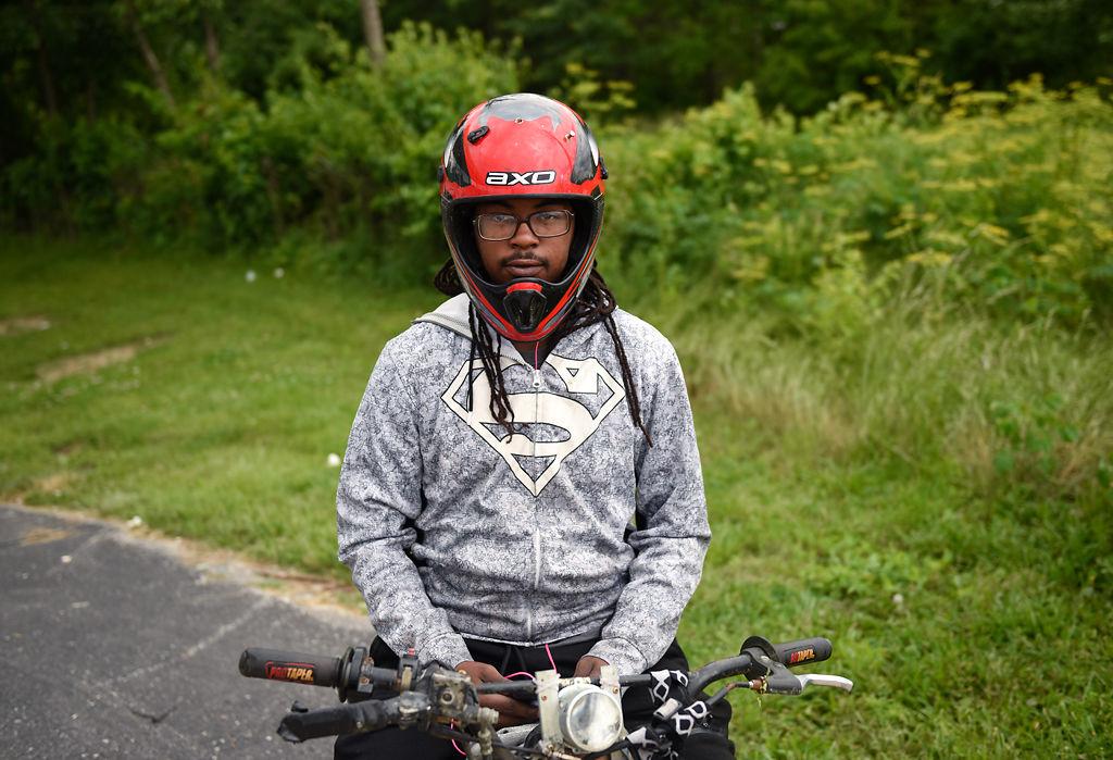Darrius Davis sits on his 125 CC Thumpstar pit bike