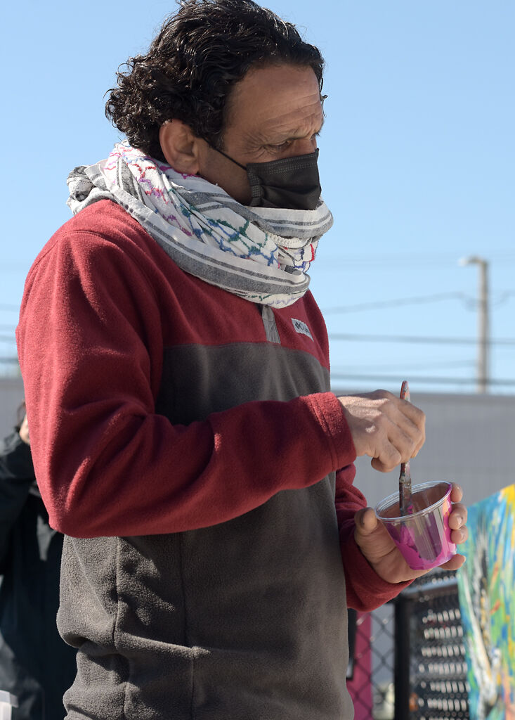 Yousef Darkhalil looks at the mural