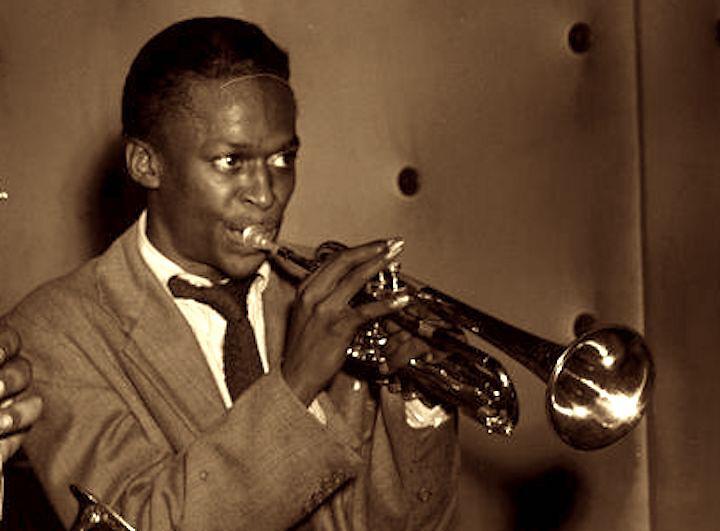 Miles Davis plays the trumpet