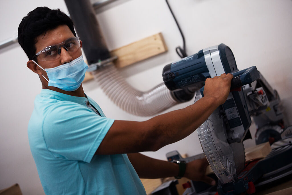 Cruz Chavez demonstrates how to use a miter saw