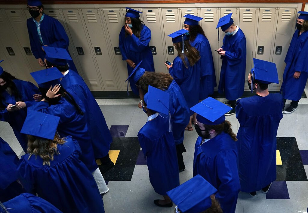Graduates gather in the hall before the ceremony begins