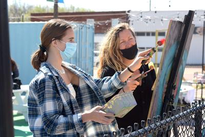 Jane O'Toole and Elaine O'Toole paint a mural