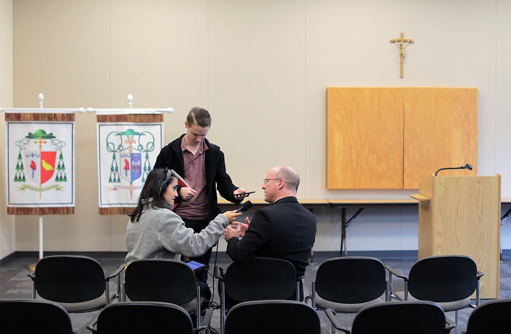 Reporters from KBIA interview Bishop Shawn McKnight