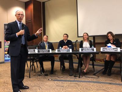 Bruce Landsberg moderates a panel discussing distracted driving