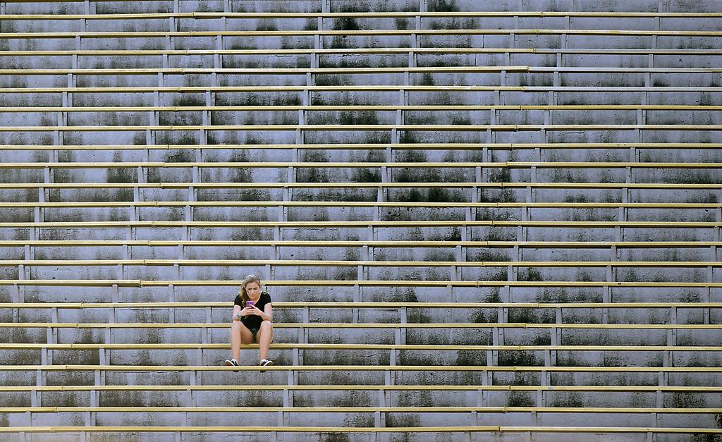 A Missouri fan sits in empty stands