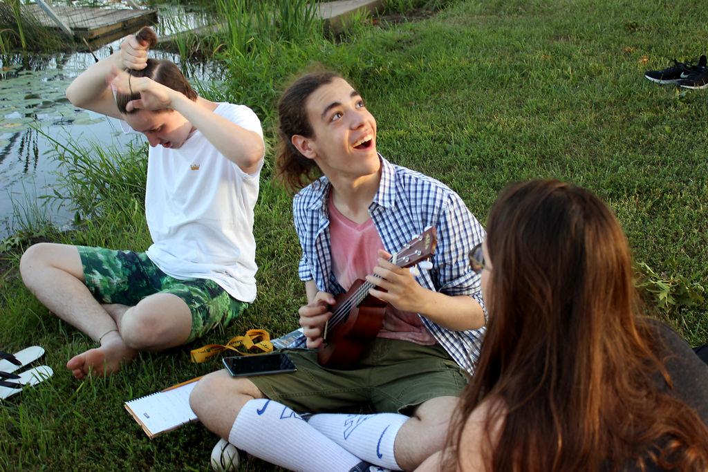 "Giancarlo ""Gian"" Araujo Auriemma plays ukelele at the Mizzou International Experience bonfire"