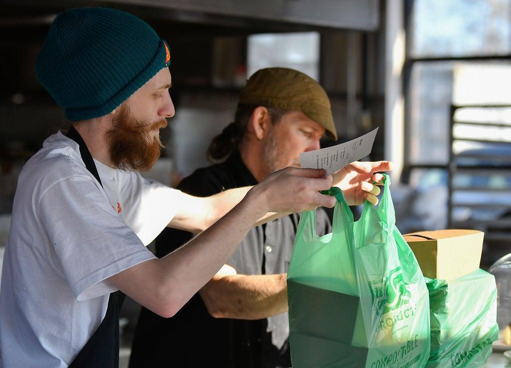 Zach Osborne, left, and Jody Schomaker pack up an online order