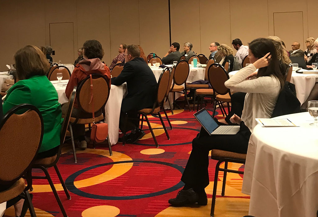 The audience at the 17th Annual Health Policy Summit listens intently to the three speakers