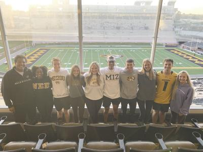 The top 10 homecoming royalty candidates pose for a photo