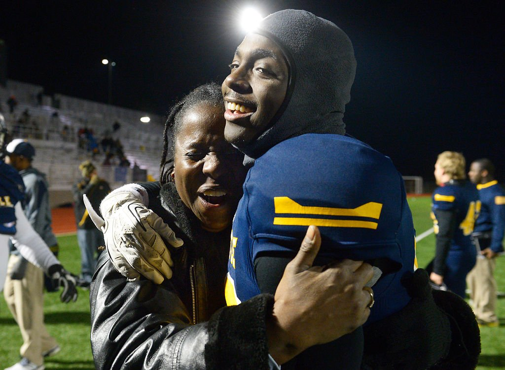Tasca McHenry-Tolson cries as she hugs her son