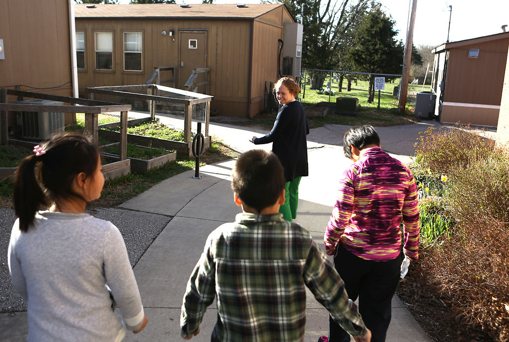 Katie Cook leads her students to her classroom