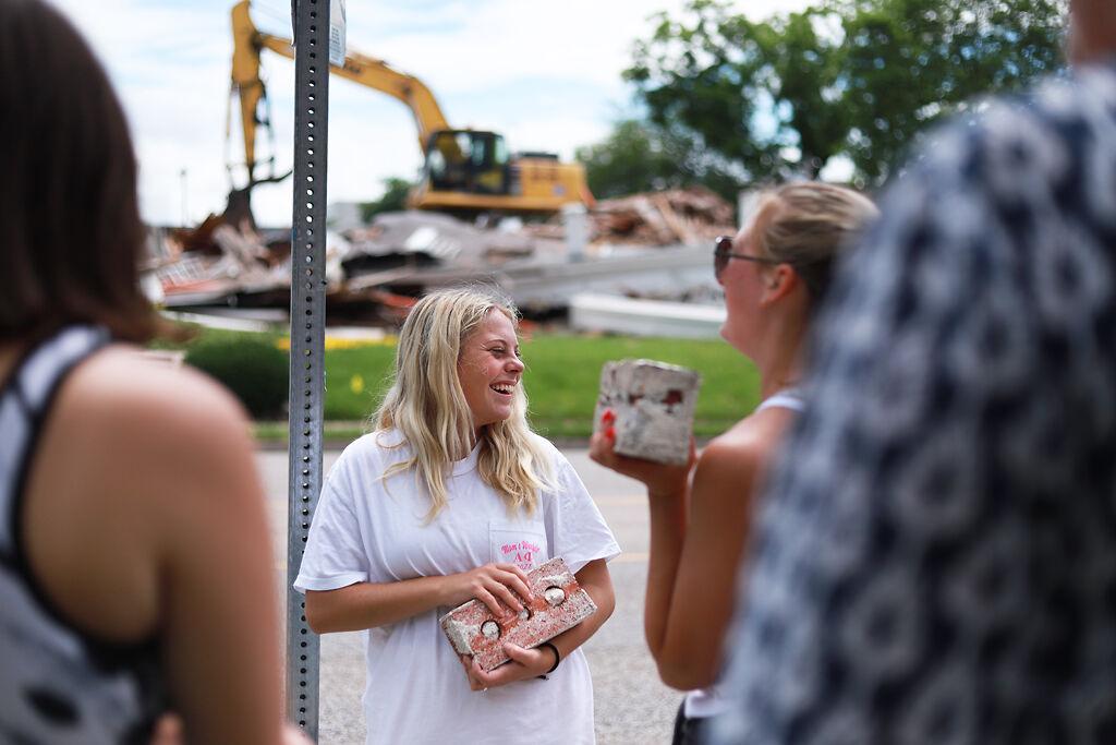 Hannah Moore holds a brick
