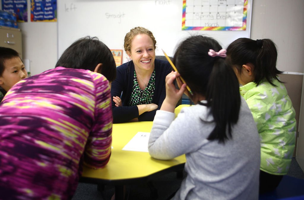 Katie Cook smiles at her students