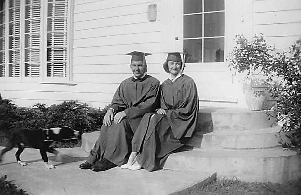 Linda and Tom Atkins pose on graduation day in 1952
