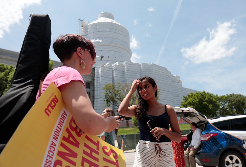 Violet Vonder Haar and Najeebah Hussein talk at a protest at the Capitol