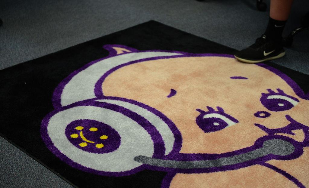 A Kewpie rug lays on the floor of Hickman High School's gaming room