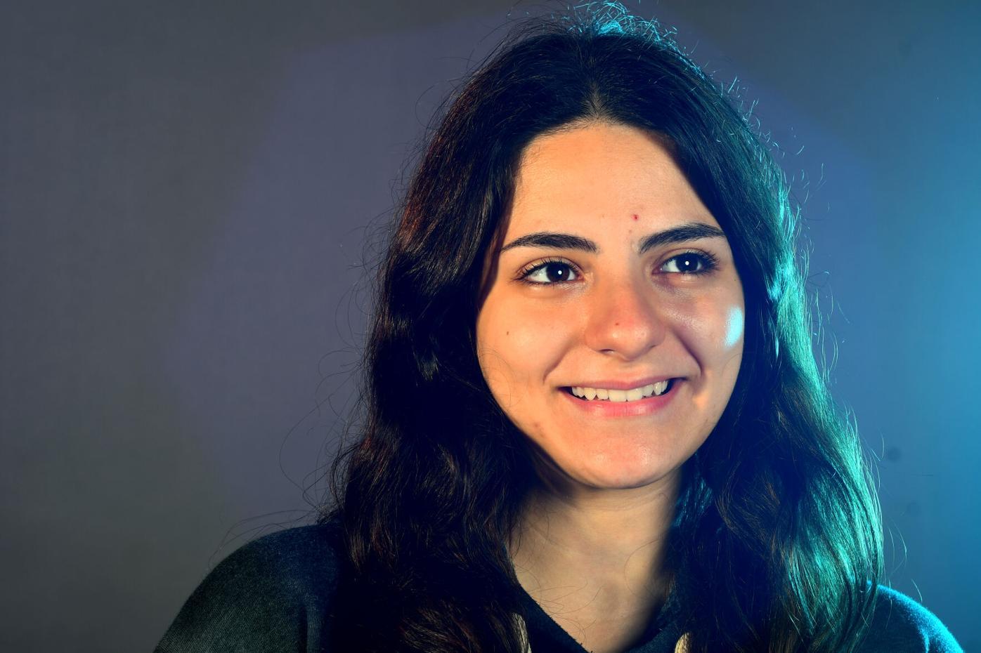 MU freshman pre-med student Fatima Almansouri smiles for a portrait