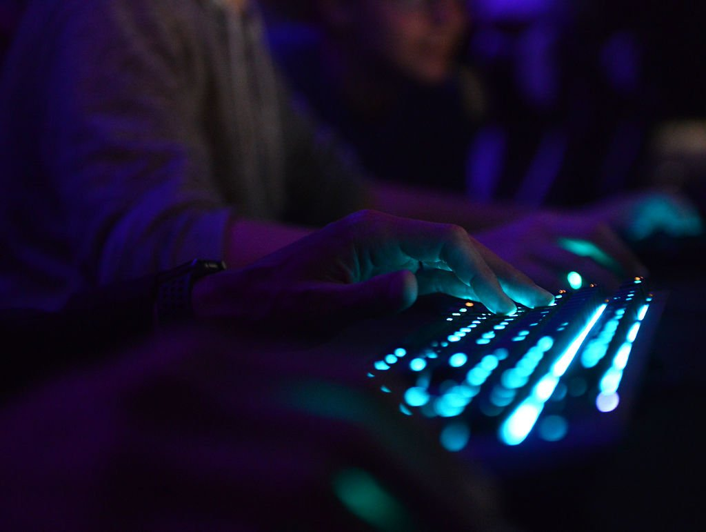 Abe Bahadori's rests his hands on the keyboard in Hickman High School's eSports room