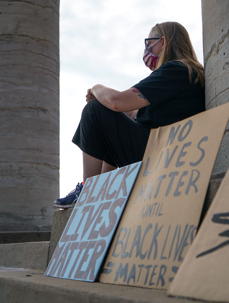 Kat Kelley waits for the march to begin