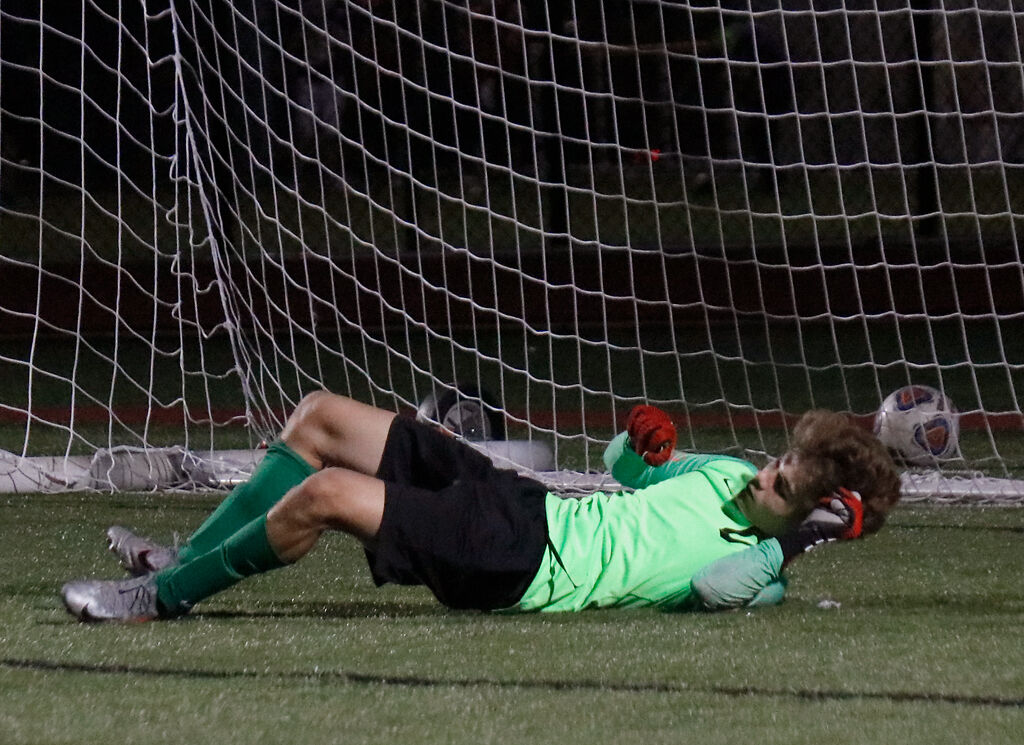 Hickman goalkeeper Eli Larson protects the goal
