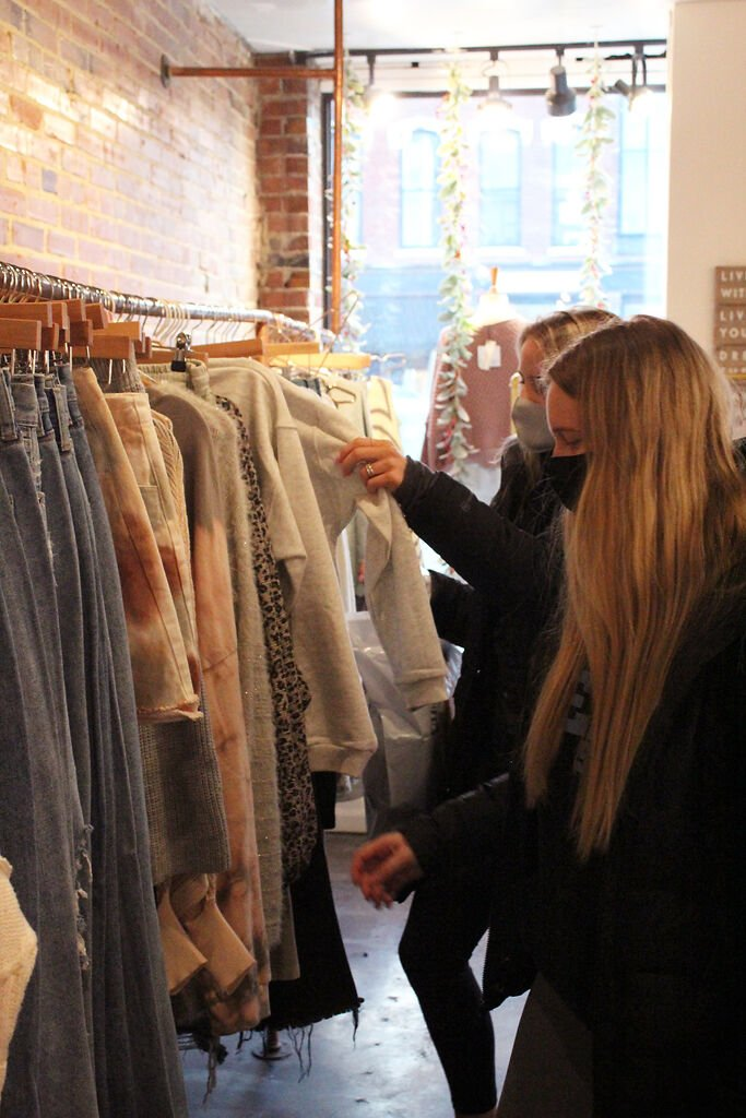 Brooke Westhoff and Mara Fenwick browse the racks