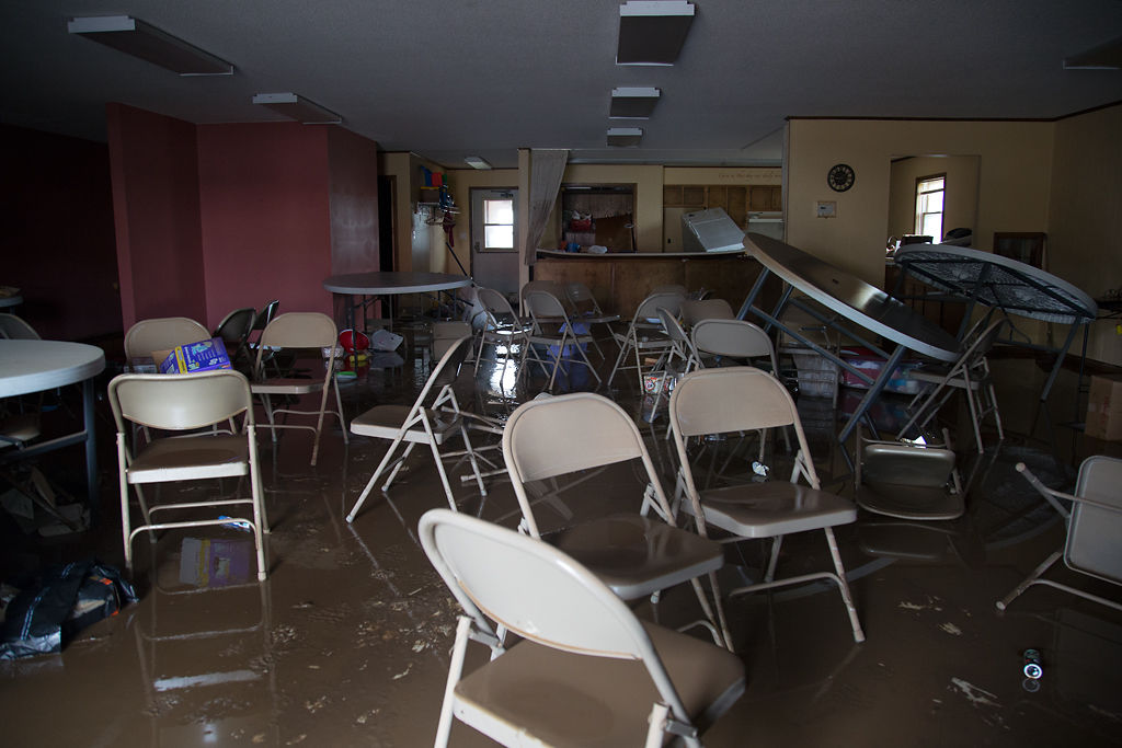 The remnants of First Baptist Church sit in muddy water