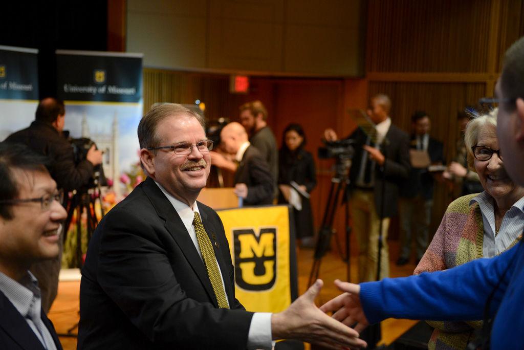 MU Chancellor Alexander Cartwright greets Ryan Owens