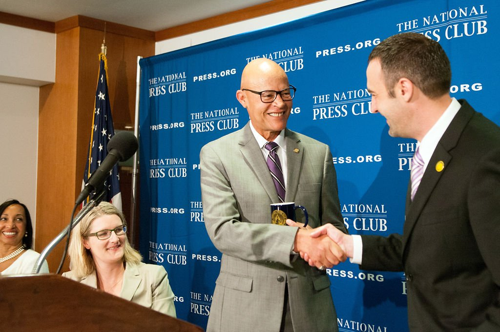 Mike Middleton accepts the traditional National Press Club mug