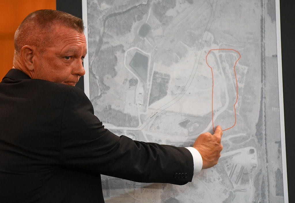 David Sorrell shows the approximate location in the landfill where human remains were discovered