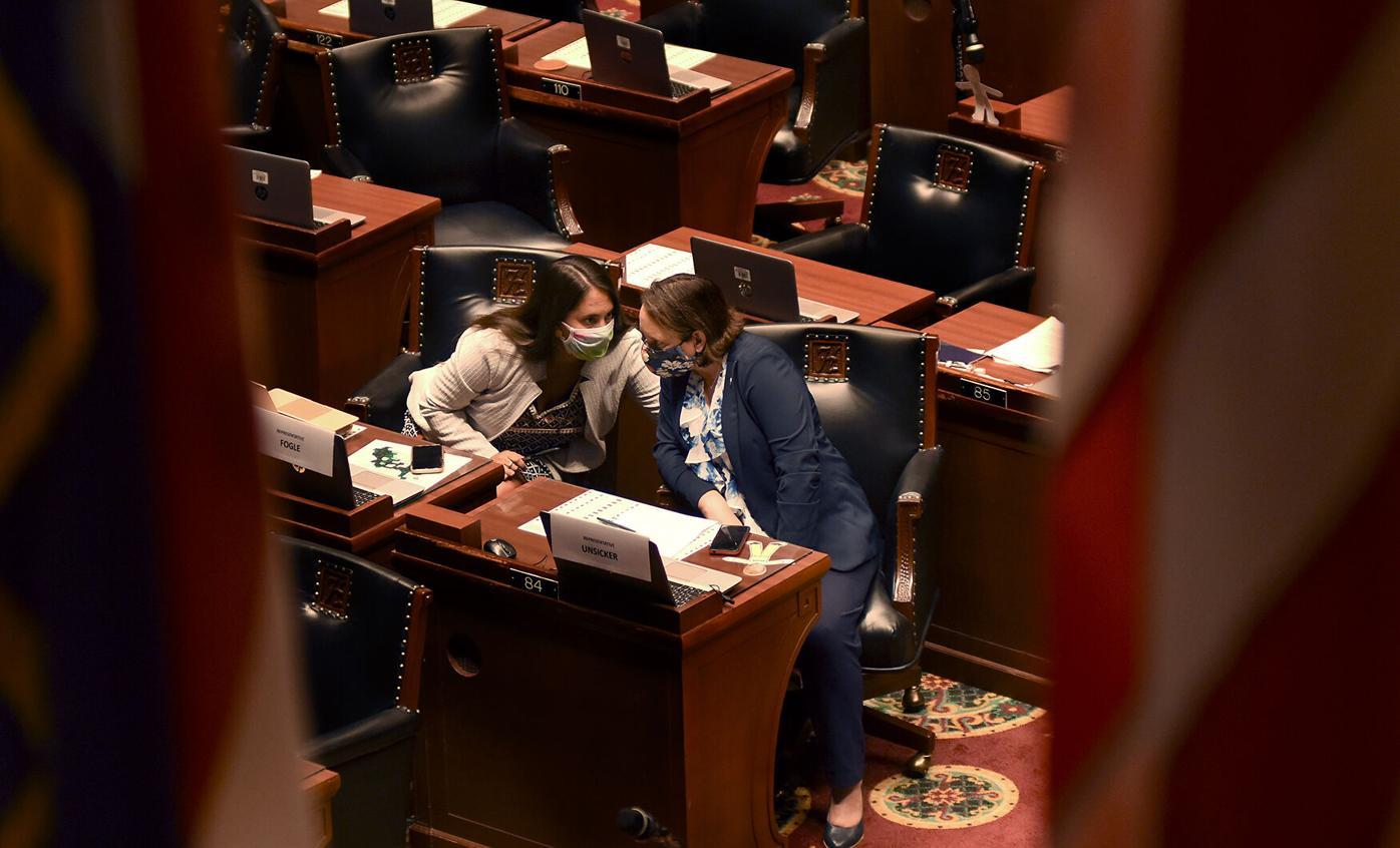 Rep. Betsy Fogle, left, talks to Rep. Sarah Unsicker