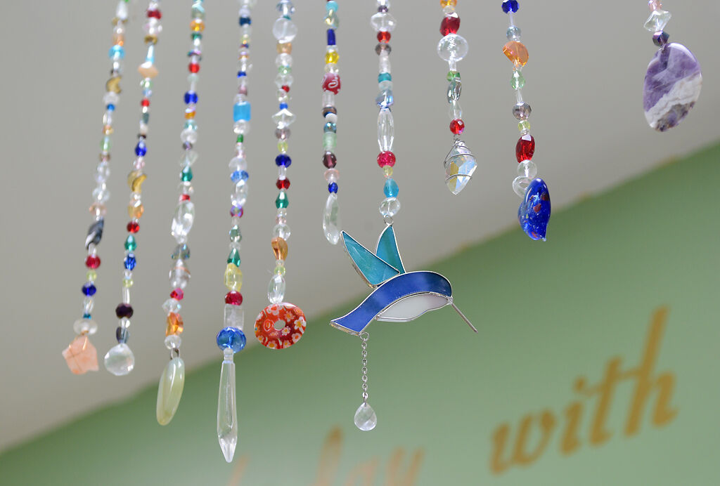 Colorful beads dangle from the ceiling inside