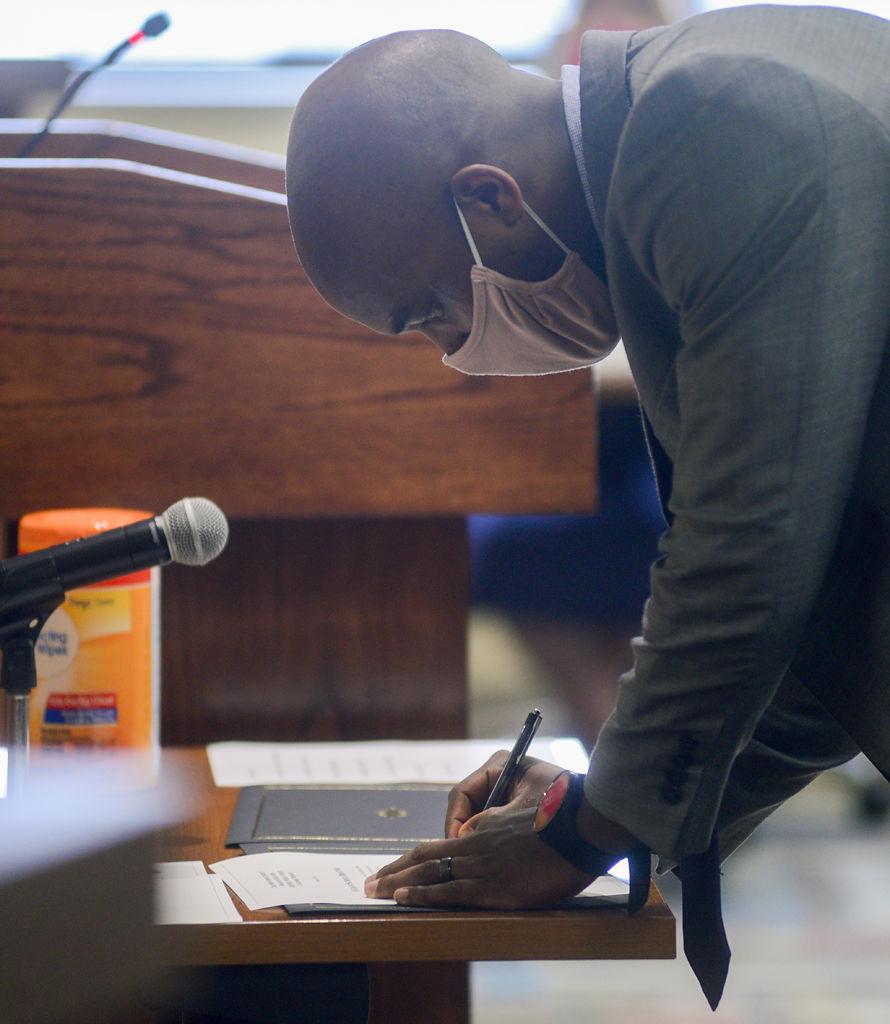 David Seamon signs paperwork