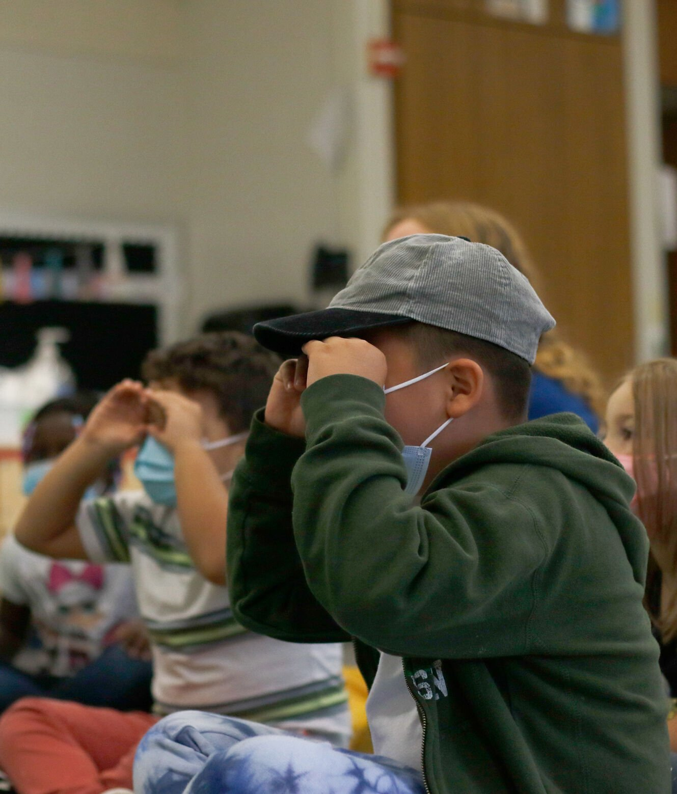 Students use their hands to emphasize focus during